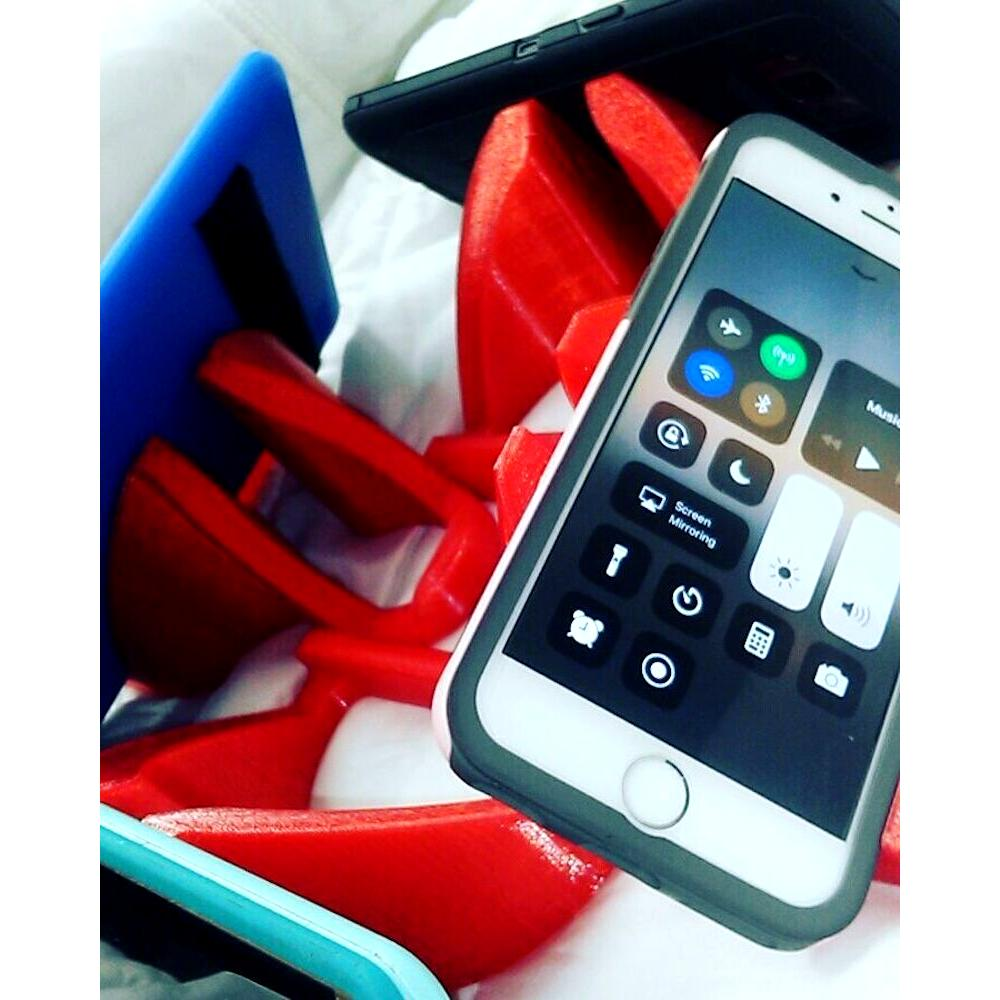 Phone and tablet holders in use teenager laugh emoji_clipped_rev_1